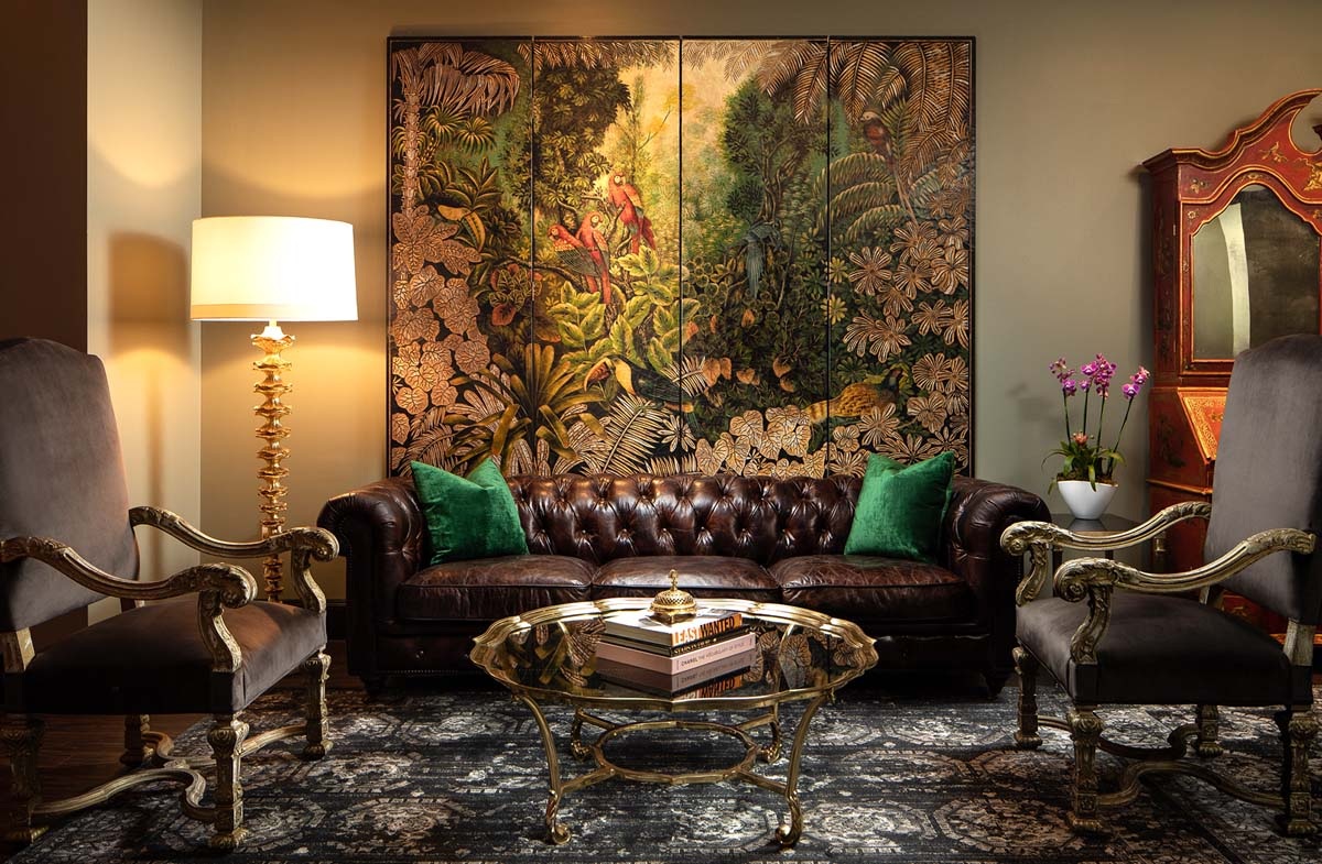 The Magnificent Seven Orient Express sitting room is decked in rich fabrics and deep colors